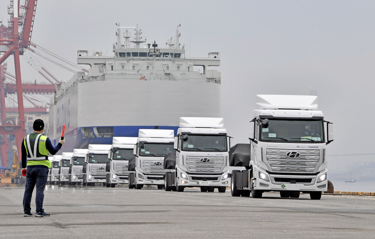 XCIENT trucks are moving to be loaded to a car carrier for export to Switzerland at Gwangyang Port, South Jeolla Province, on Monday. (Hyundai Motor Group)