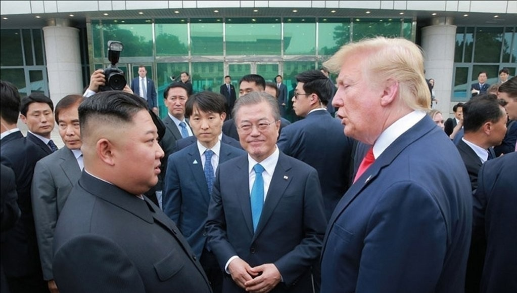 North Korean Leader Kim Jong-un, South Korean President Moon Jae-in, US President Donald Trump (left to right) at a three-way gathering in the inter-Korean border village of Panmunjom in June 2019 (KCNA-Yonhap)