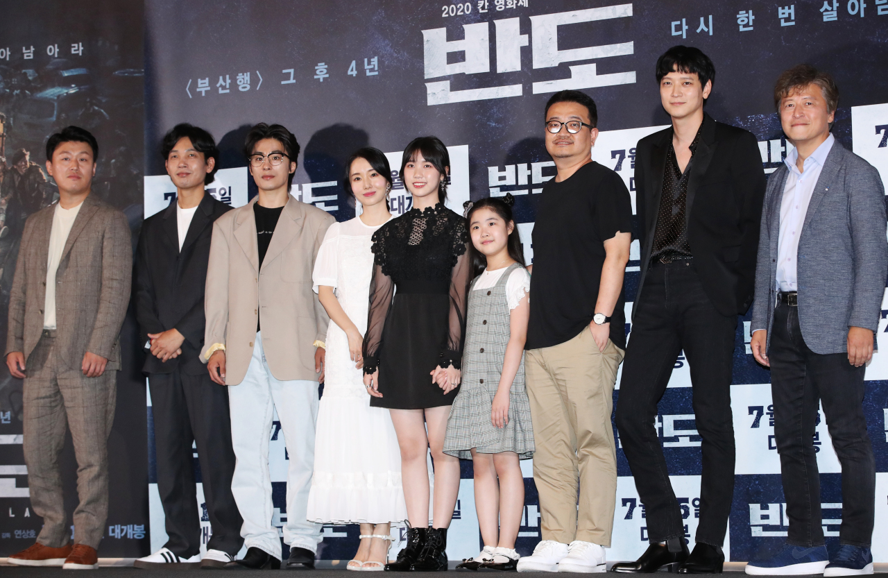 "From left: Actors Kim Min-jae, Kim Do-yun, Koo Kyo-hwan, Lee Jung-hyun, Lee Re, Lee Ye-won, director Yeon Sang-ho, actors Gang Dong-won and Kwon Hae-hyo of ""Peninsula"" pose for pictures during the press premiere event held Thursday in Seoul. (Yonhap)"