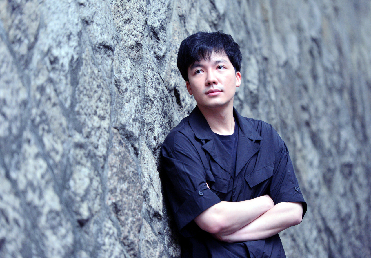 Director Kim Do-joon poses before an interview with The Korea Herald on June 26. (Park Hyun-koo/The Korea Herald)