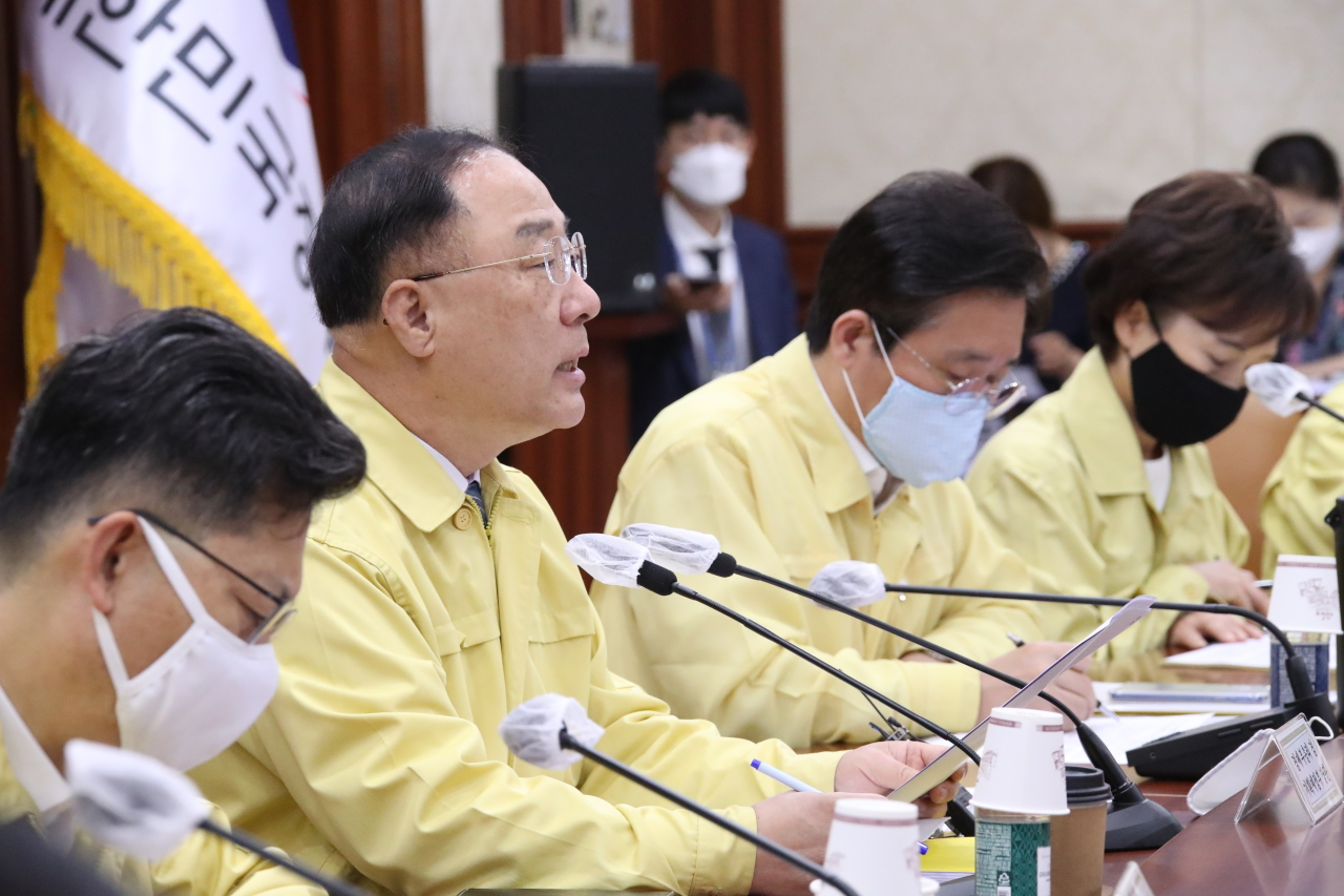 Deputy Prime Minister and Finance Minister Hong Nam-ki speaks during a meeting with economy-related ministers in Seoul on July 23. (Yonhap)