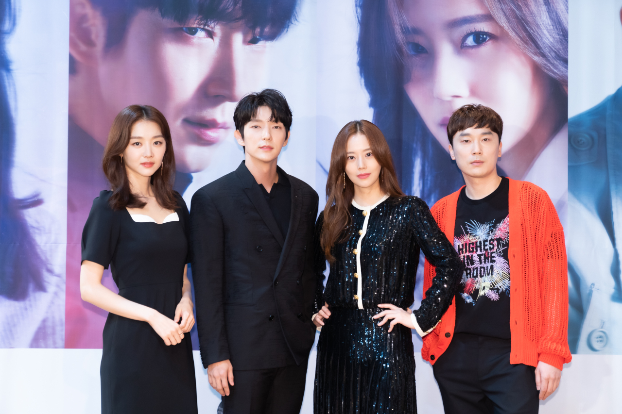 "Lead cast members of new tvN series ""The Flower of Evil"" -- (from left) Jang Hee-jin, Lee Joon-ki, Moon Chae-won and Seo Hyeon-woo -- pose for a picture at a promotional event Wednesday. (tvN)"