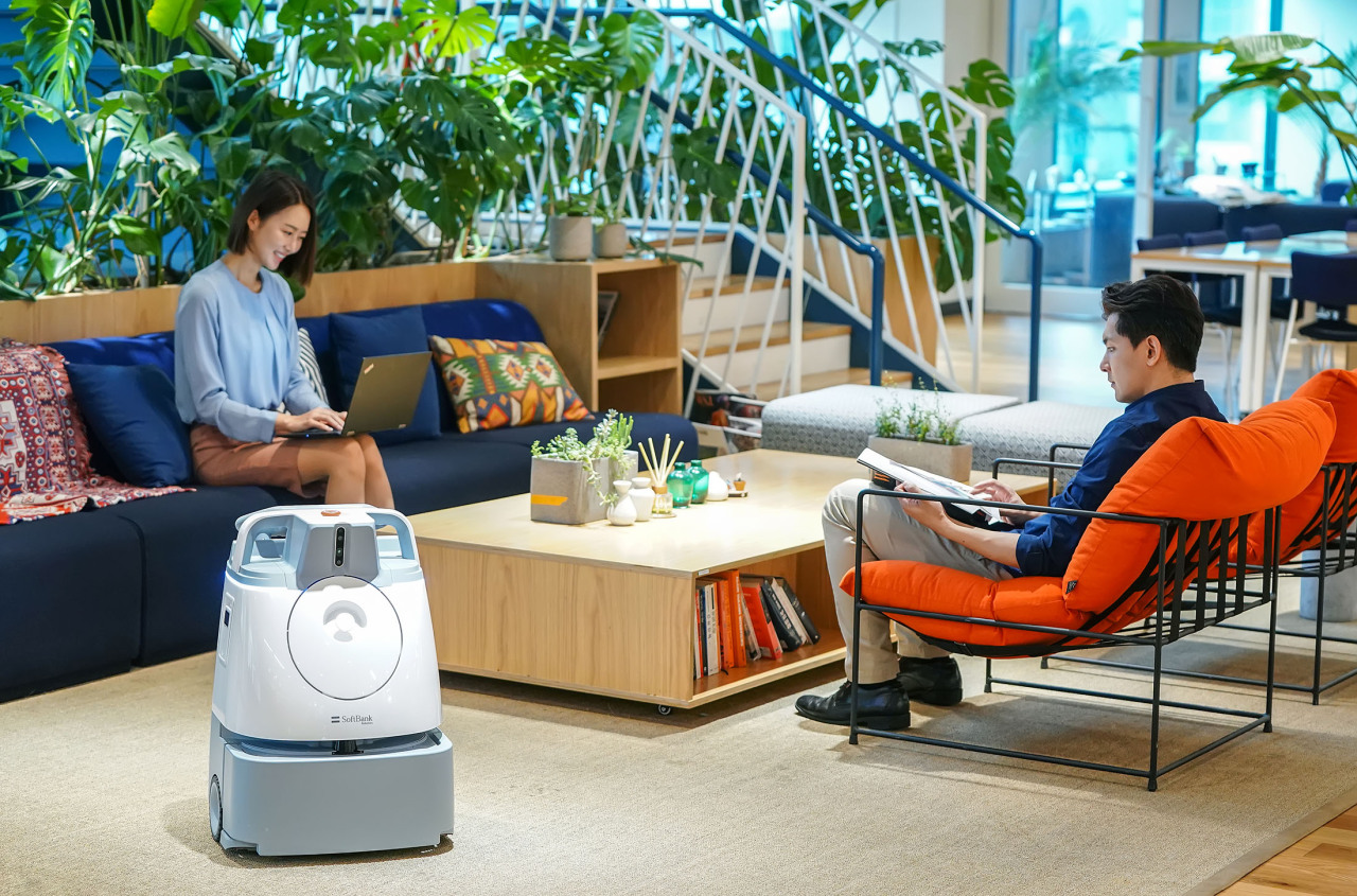 SoftBank Robotics' autonomous cleaning robot Whiz operating in an office setting (SoftBank Robotics)