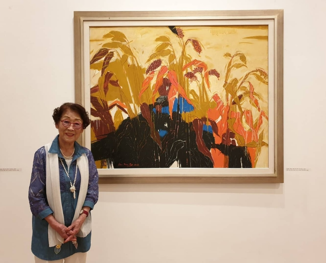 "Shin Kum-rye stands in front of ""Path"" at her solo exhibition ""The Spirit of Painting"" at Whanki Museum in Seoul (Whanki Museum)"
