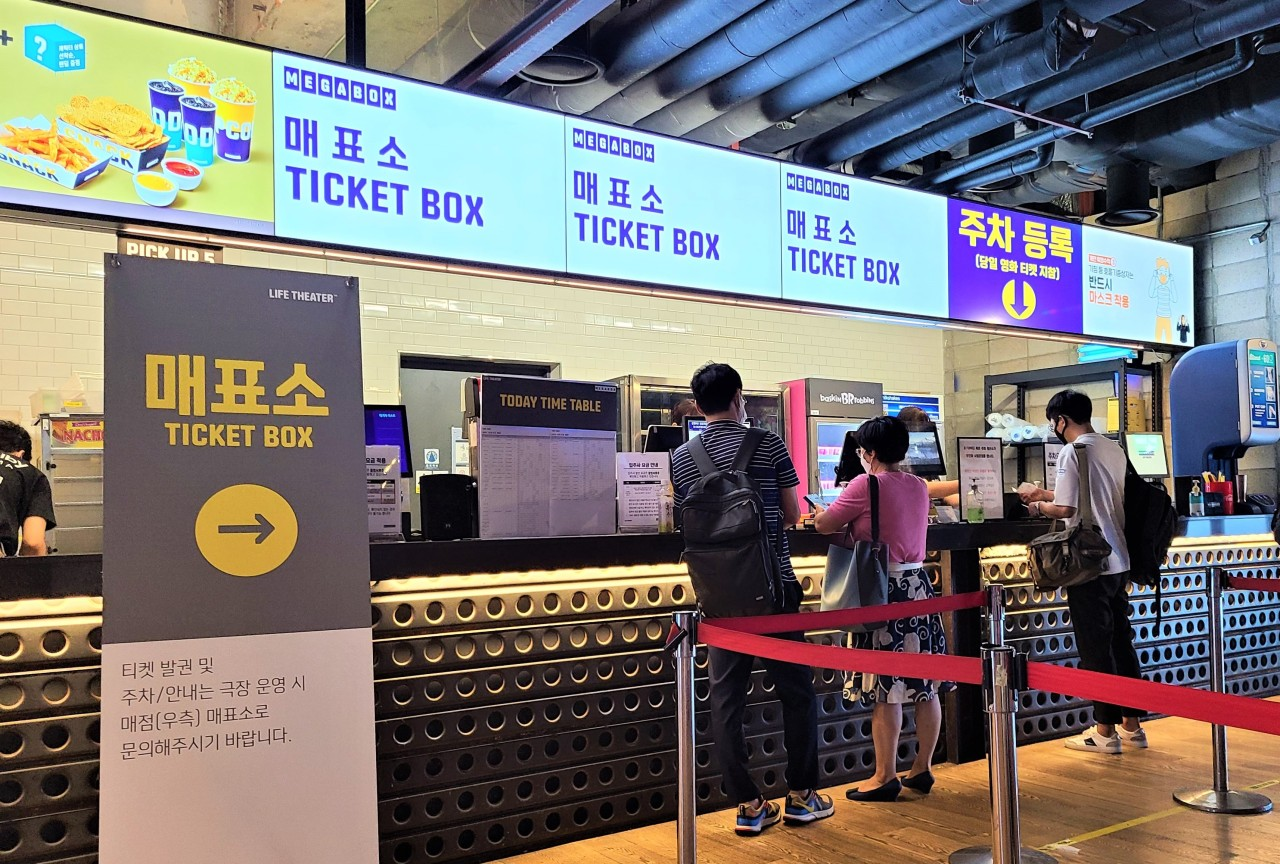 People wait in front of the ticket box at the Megabox Coex branch in Seoul on Monday. (Choi Ji-won/The Korea Herald)