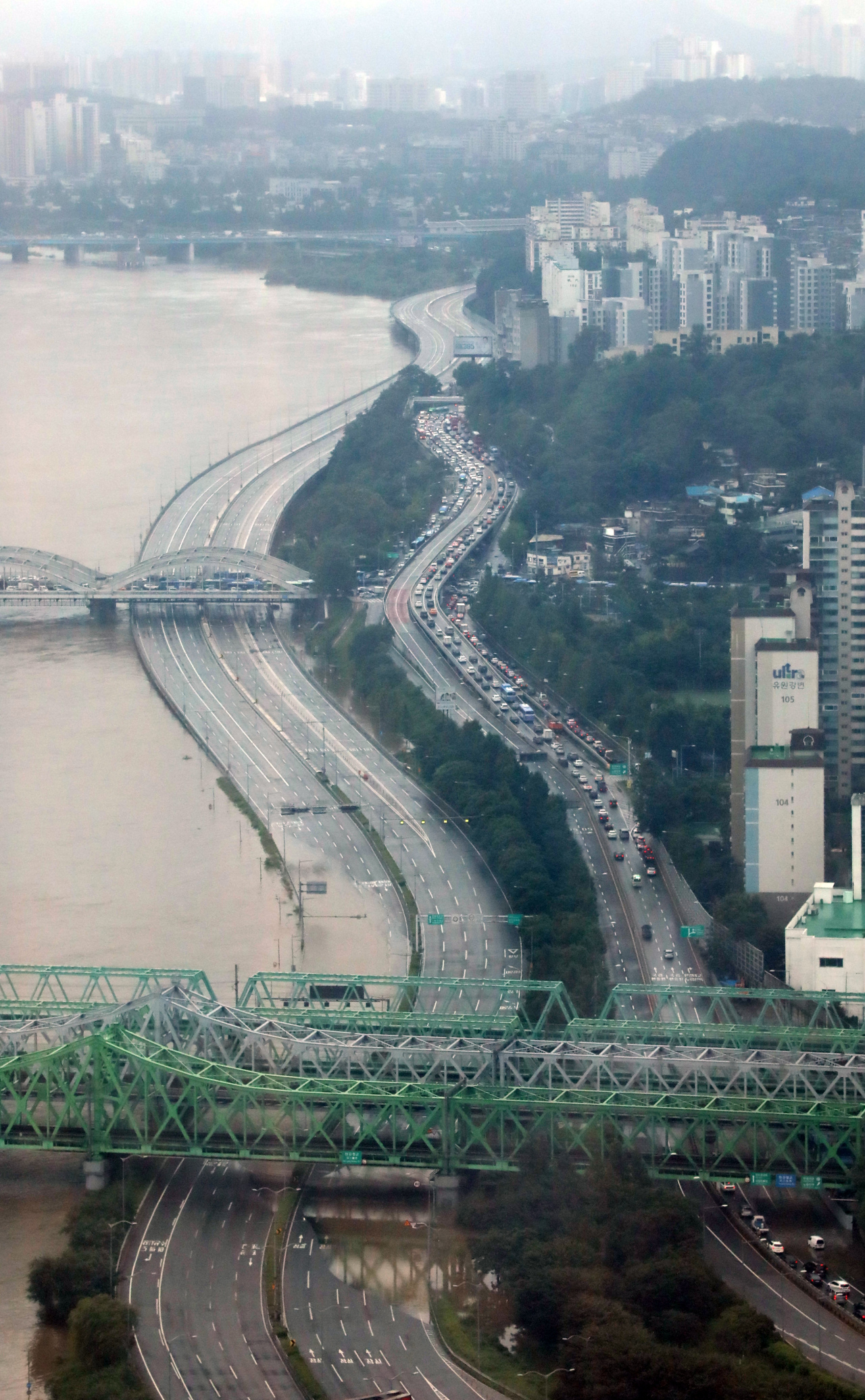 Roads along the Han River in Seoul are closed Thursday, flooded amid torrential rains. (Yonhap)