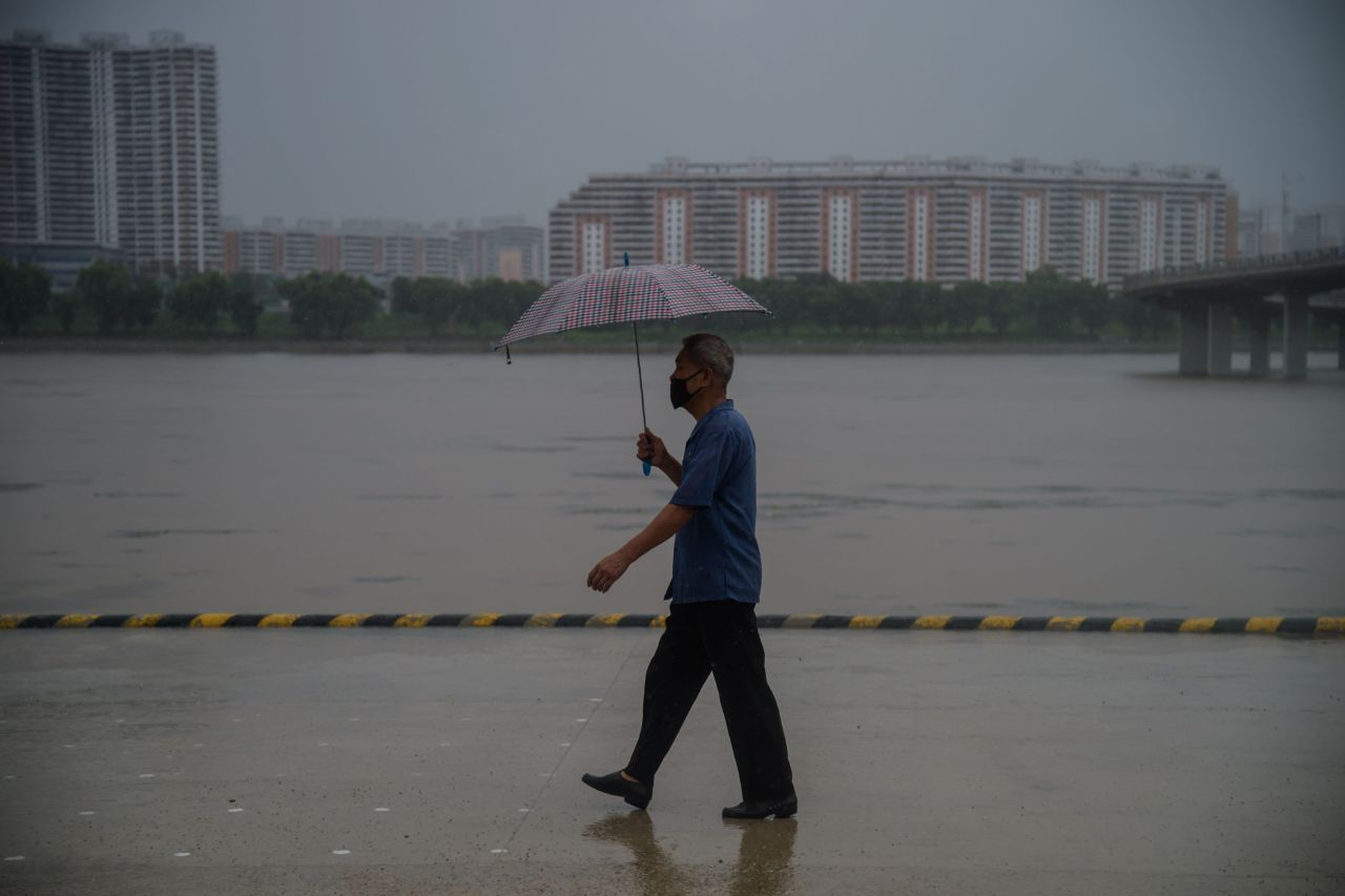 A man walks along the Taedong River in Pyongyang on Wednesday. (AFP-Yonhap)