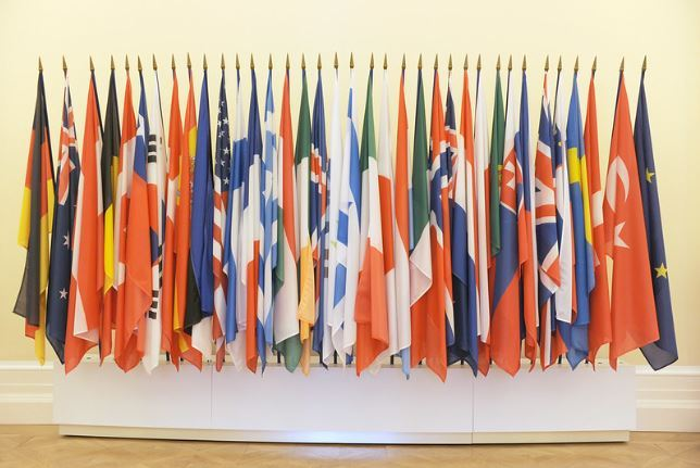 Flags of the members of the Organization for Economic Cooperation and Development are seen at its headquarters in Paris. Three more added to 37 in total after the photo was taken. (OECD)
