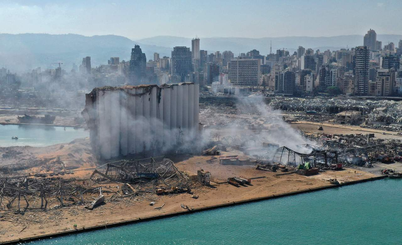 An aerial view shows the massive damage done to Beirut port's grain silos and the area around it on Wednesday, one day after a mega-blast tore through the harbor in the heart of the Lebanese capital with the force of an earthquake, killing more than 100 people and injuring over 4,000. (AFP-Yonhap)