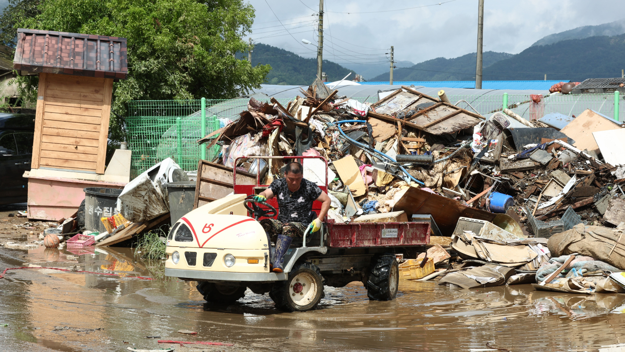 Recovery work is underway Wednesday in a village in Namwon, North Jeolla Province, which has been hit by flash floods triggered by recent torrential rains. (Yonhap)
