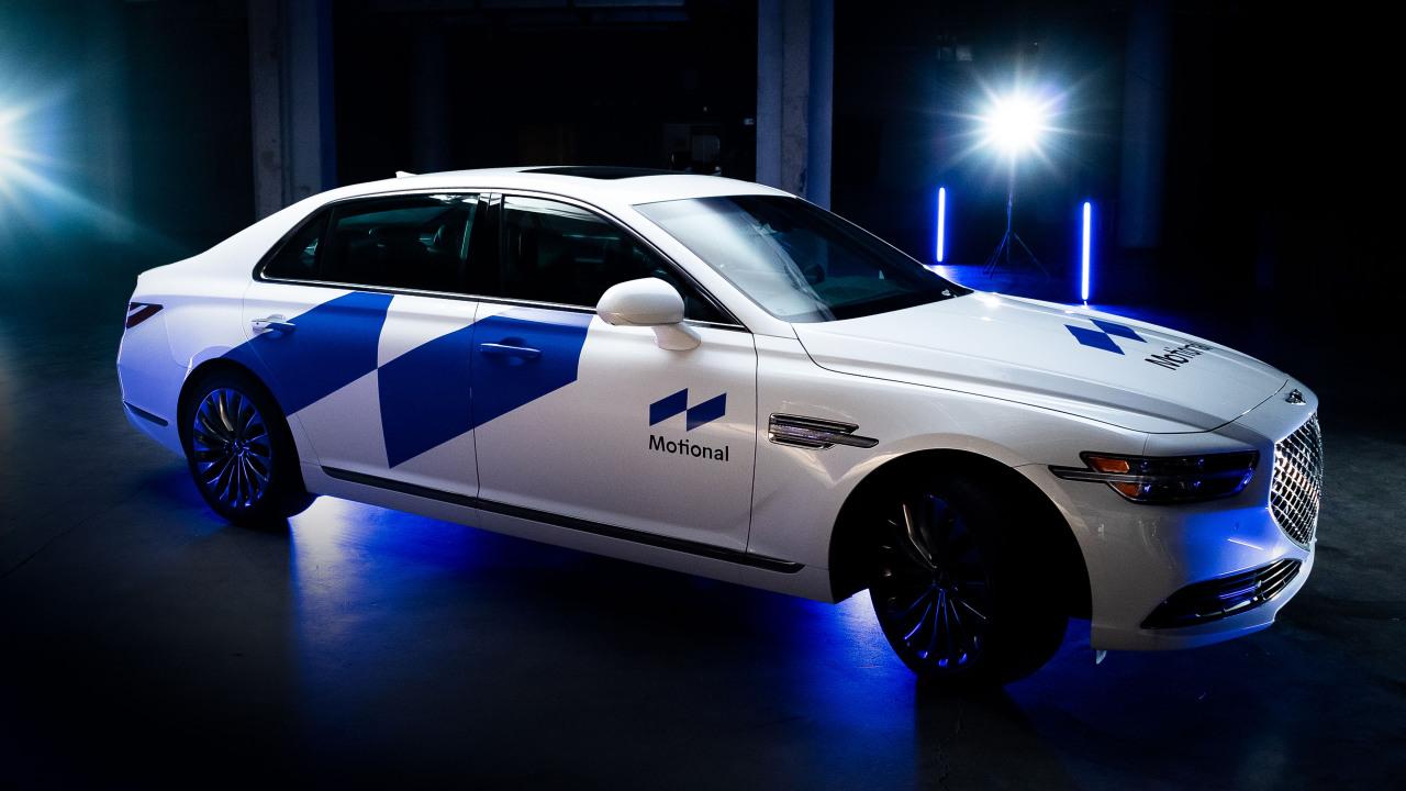 Genesis G90 presented with Motional brand logo (Hyundai Motor Group)