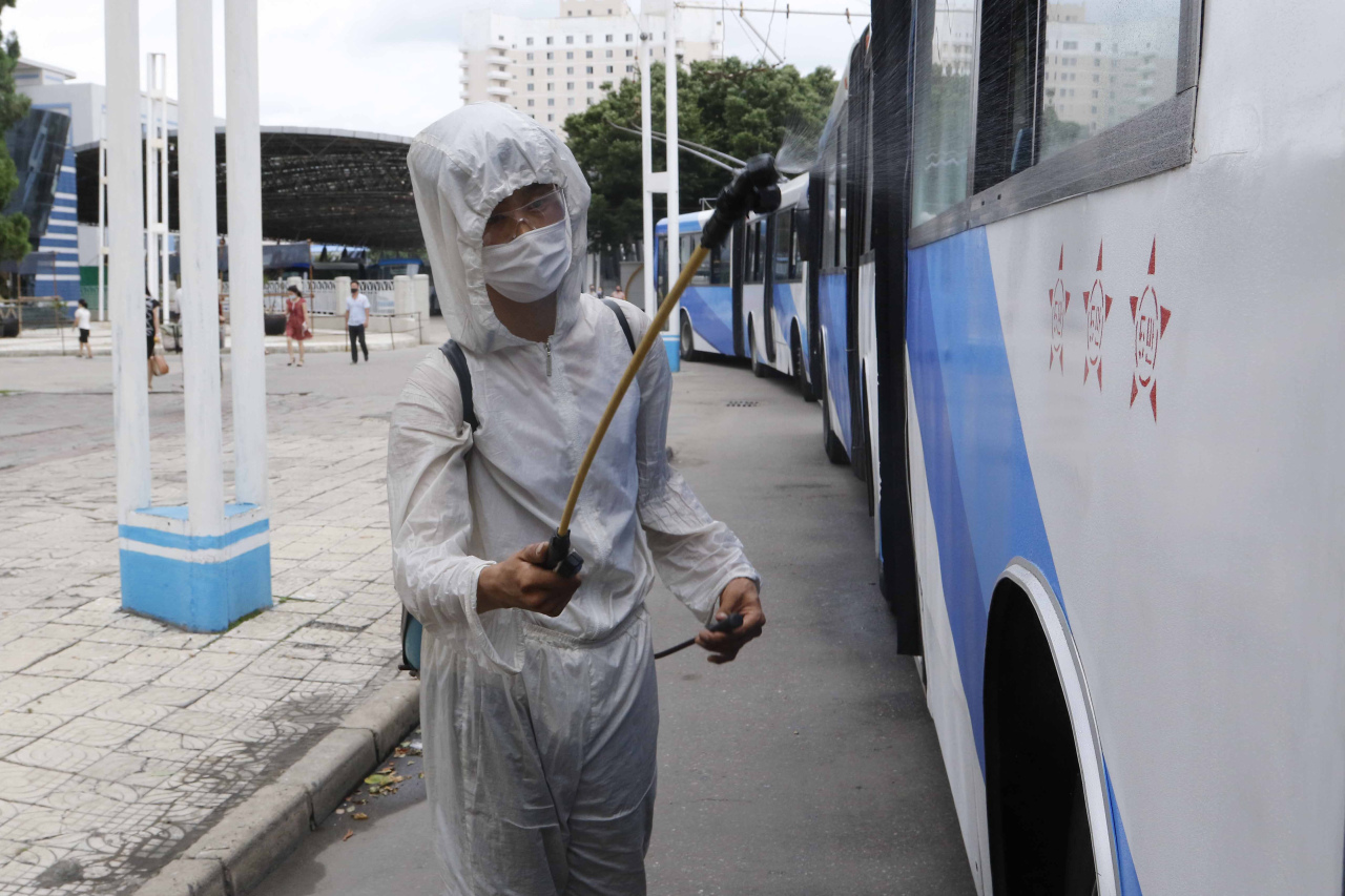 A man in a protective suit disinfects a trolley bus to help curb the spread of the coronavirus in Pyongyang, North Korea, Thursday. (AP-Yonhap)
