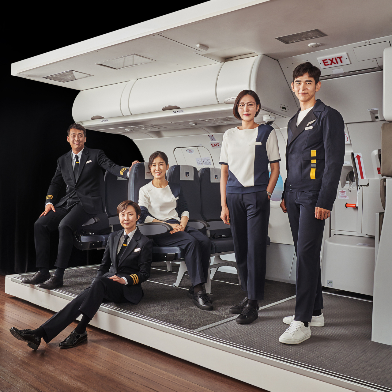 Aero K staff wear the airline's gender-neutral uniforms. (Aero K)