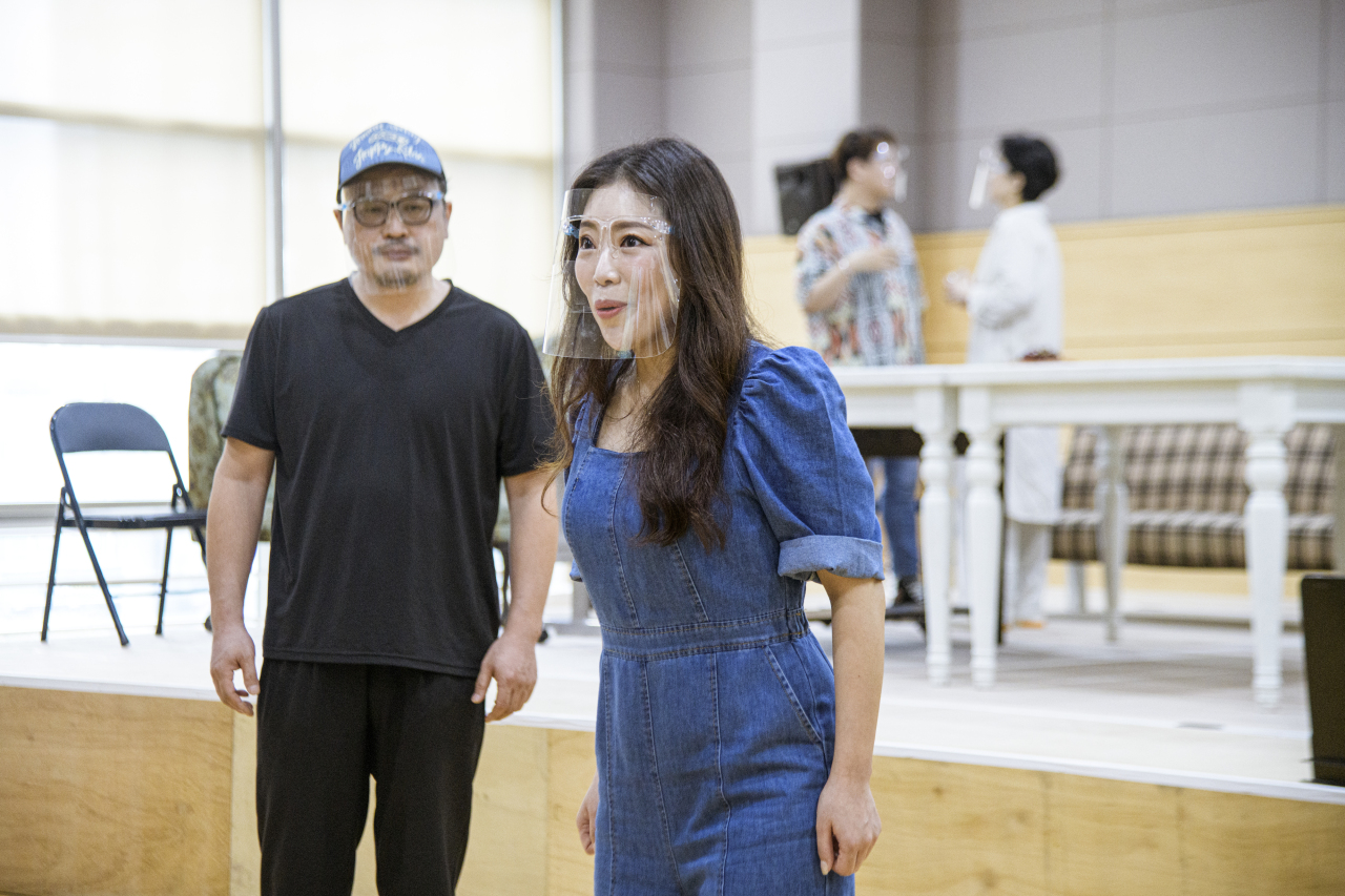 "The ""Red Pants"" cast rehearses at the Chungmu Arts Center on Aug. 15, wearing protective gear. (KNO)"