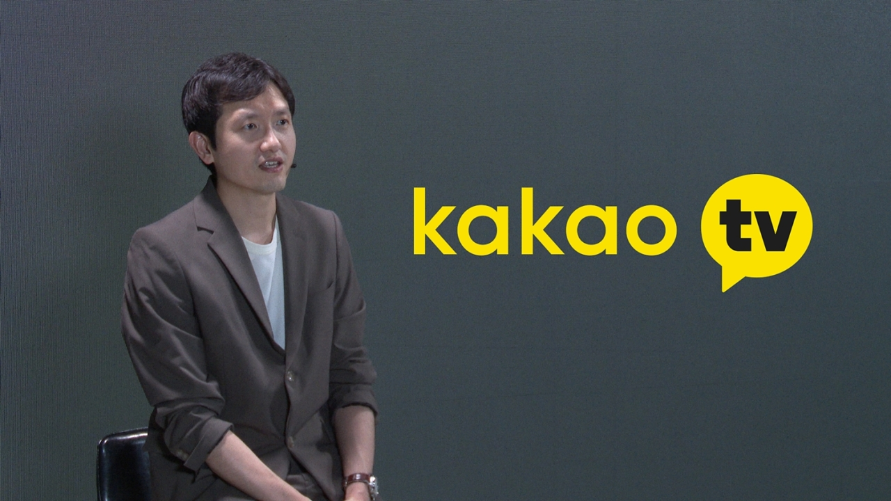 Shin Jong-su, director of Kakao M's digital media content department, speaks in a prerecorded video released Tuesday. (Kakao M)