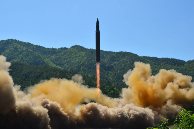 North Korea test-fires a Hwasong-14 ballistic missile on July 4, 2017. (Yonhap)