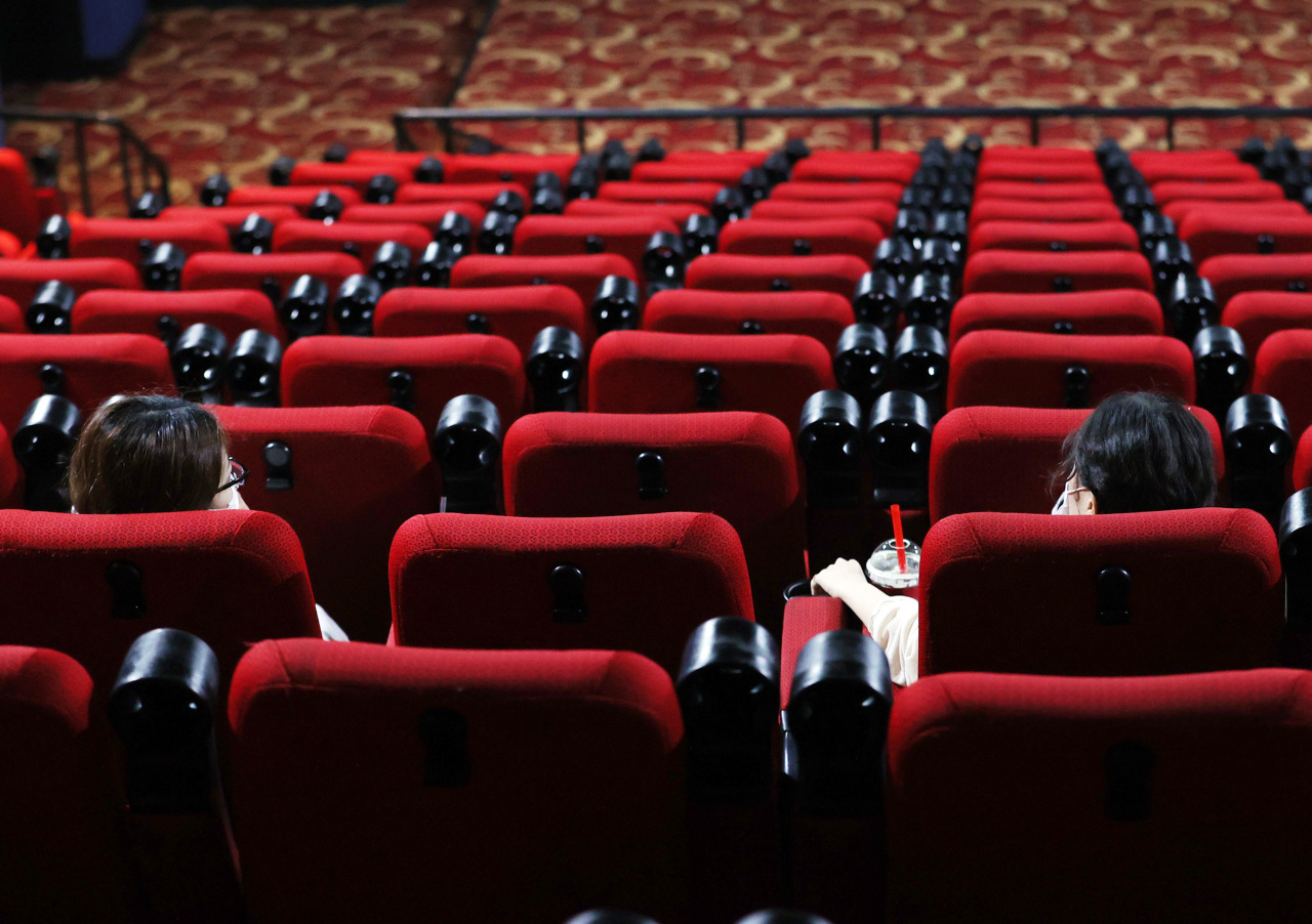 Two people are seated apart in a local cinema in Seoul on Aug. 26 in compliance with social distancing measures. (Yonhap)