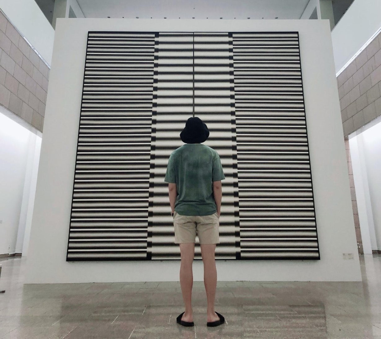 "BTS's RM views the exhibition, ""Lee Seung-jio: Advancing Columns"" at MMCA Gwacheon (BTS' official Twitter account)"