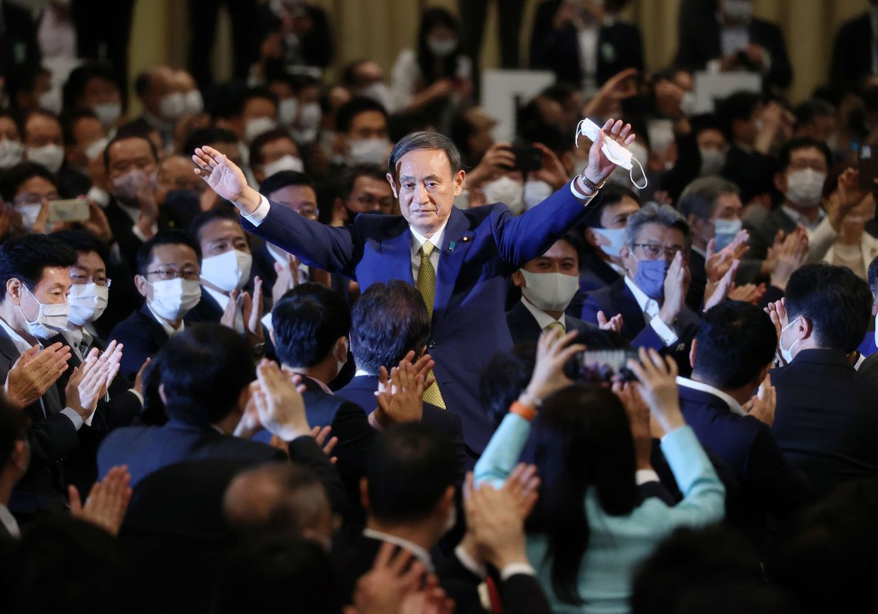 Japan's Chief Cabinet Secretary Yoshihide Suga reacts after he was elected as new head of Japan's ruling Liberal Democratic Party at the party's leadership election in Tokyo on Monday. (AFP-Yonhap)