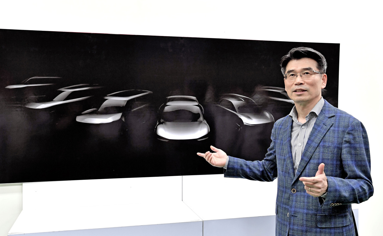 Kia Motors President Song Ho-sung explains a sketch of the company's lineup of electric cars to be released by 2027, during a visit to its Hwaseong plant, Wednesday.