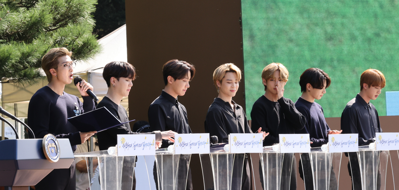K-pop boy band BTS delivers a speech encouraging younger generations during the inaugural Youth Day event at Nokjiwon, a verdant garden inside the presidential compound Cheong Wa Dae, in Seoul on Saturday. (Yonhap)