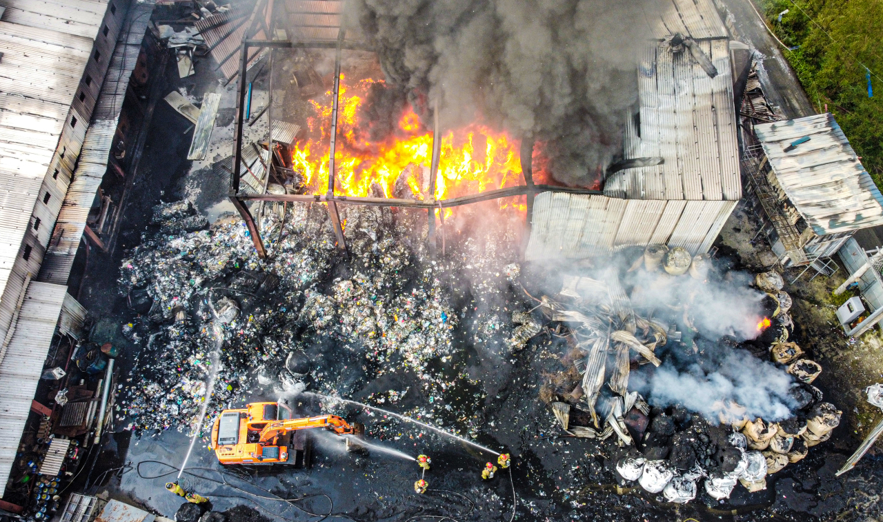 Firefighters put out a fire at a plastic waste recycling company in Pyeongtaek, south of Seoul, on Saturday. Two foreign workers were killed in the blaze. (Yonhap)