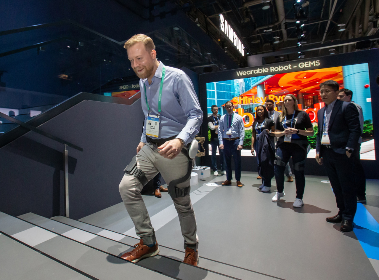 A visitor walks wearing the GEMS Hip at CES 2020 in January. (Samsung Electronics)