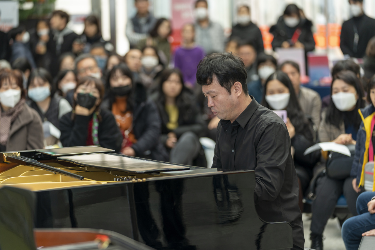 Pianist Kim Cheol-woong plays the piano at DMZ Museum in Goseong, Gangwon Province, on Feb. 22 during the winter edition of Music in PyeongChang 2020. (MPyC)