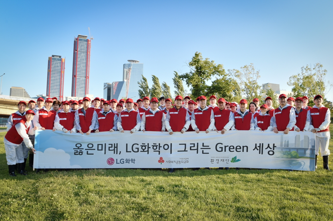 LG Chem employees pose for a picture during the company's volunteer program that works to protect the ecosystem of Bamseom, a pair of uninhabited islets on the Han River in Seoul. (LG Chem)