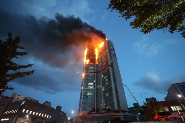 Shocking footage shows fire engulfing 33-storey building