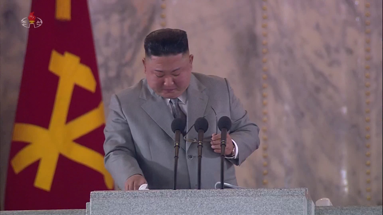 This image taken from North Korean Central TV shows North Korean leader Kim Jong-un taking off his glasses to wipe away tears while he addresses crowds gathered for the 75th year anniversary of the foundation of the country's ruling Workers' Party in Pyongyang on Saturday. (Yonhap)