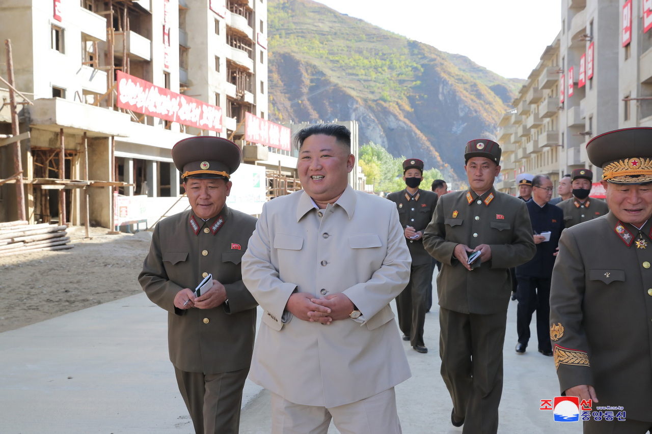 North Korean leader Kim Jong-un inspects typhoon-hit Komdok area in South Hamgyong Province, according to the Korea Central News Agency report on Wednesday. (KCNA-Yonhap)