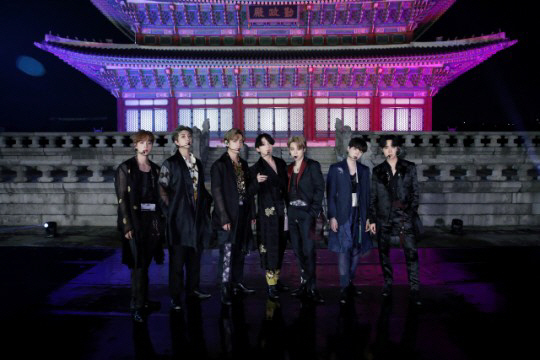 BTS poses for a photo in front of Geunjeongjeon Hall of Gyeongbokgung in Seoul on Sept. 29. (Big Hit Entertainment)