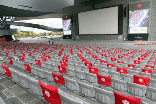 Seats at the outdoor theater of the Busan Cinema Center in Busan are marked for social distancing on Wednesday. (Yonhap)
