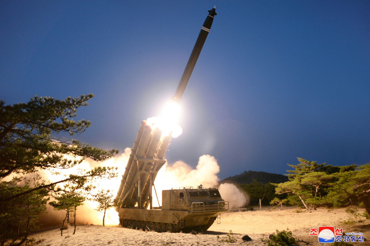 North Korea fires a pair of super-large rockets into the East Sea in its fourth weapons test of the year, March 29, 2020. (KCNA-Yonhap)