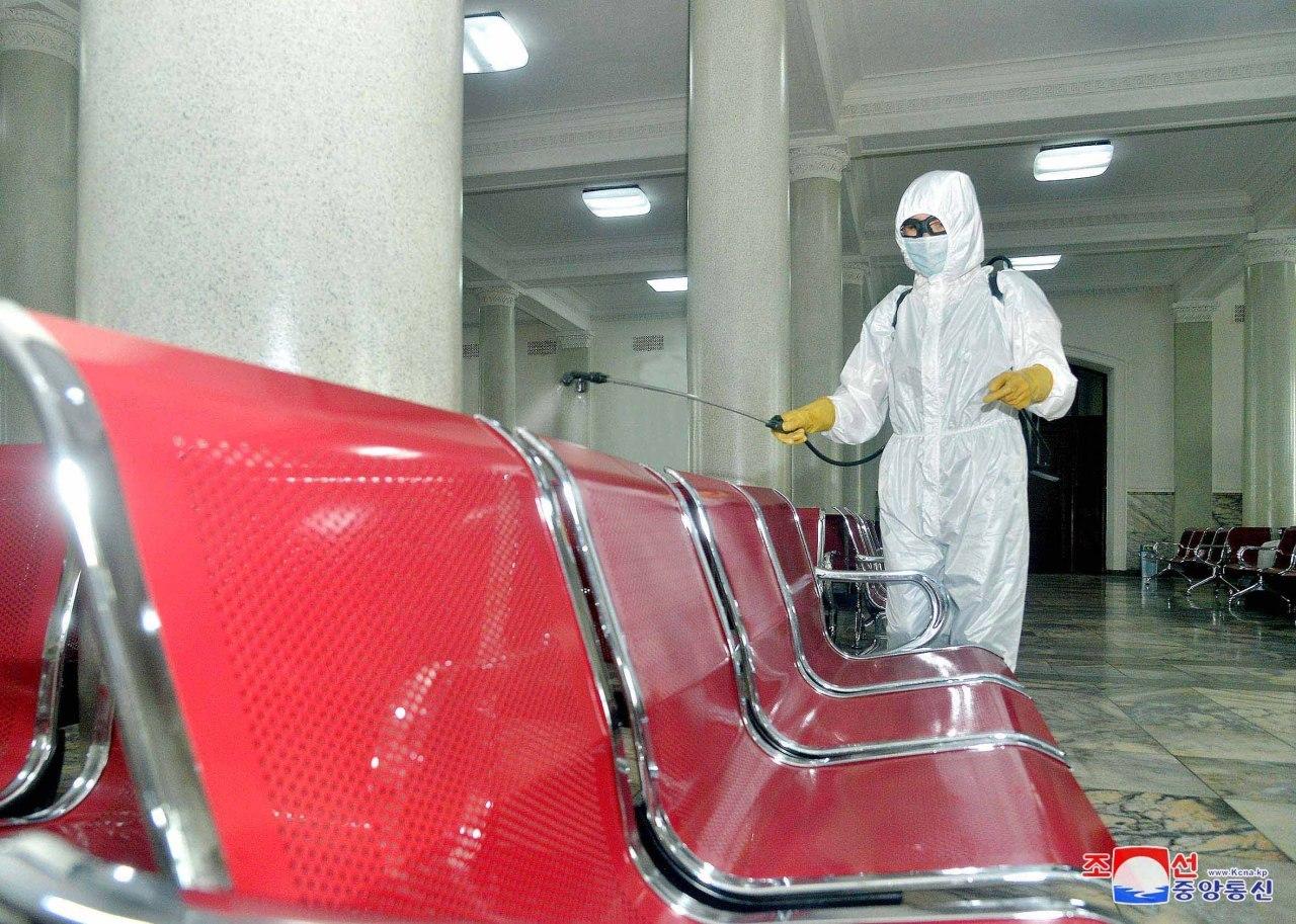 An official disinfects seats at Pyongyang station (KCNA-Yonhap)