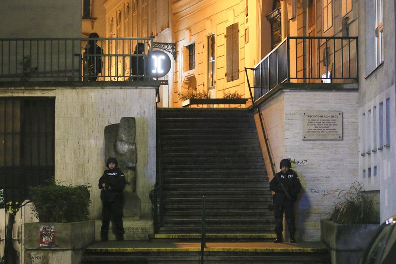 Police officers stay in position at stairs named 'Theodor Herzl Stiege' near a synagogue after gunshots were heard in Vienna, Monday. (AP-Yonhap)