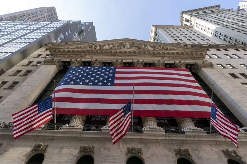 In this Monday file photo, a giant American Flag hangs on the New York Stock Exchange. US stocks are climbing Monday, kicking off a potentially turbulent stretch for markets, as Wall Street recovers some of its sharp sell-off from last week. (AP-Yonhap)