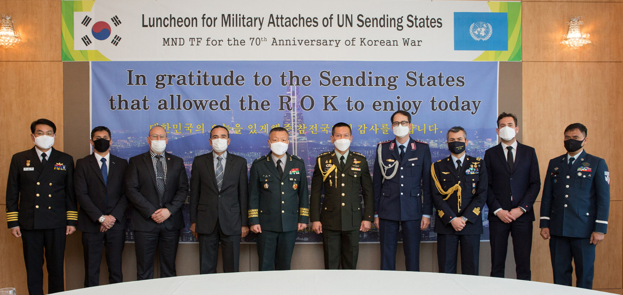 In this photo provided by the defense ministry, participants at a luncheon for military attaches of countries that took part in the Korean War pose for a photo in Seoul last Wednesday. (Ministry of Defense)