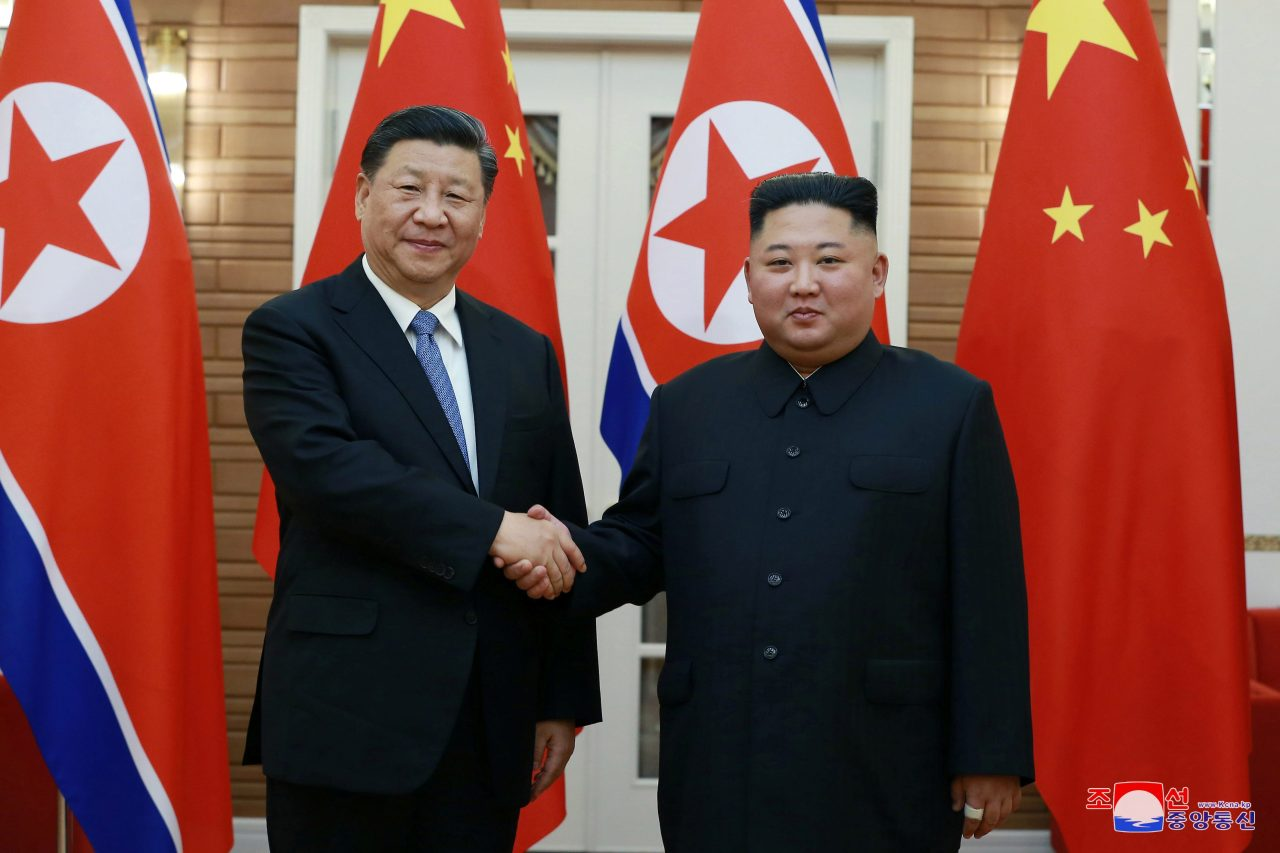 In the June 20, 2019, photo, released by the North's official Korean Central News Agency, Chinese President Xi Jinping (L) shakes hands with North Korean leader Kim Jong-un prior to their summit talks in Pyongyang. (KCNA-Yonhap)