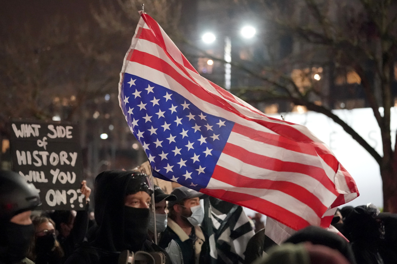 People march on the night of the election in Seattle, Tuesday. (AP-Yonhap)