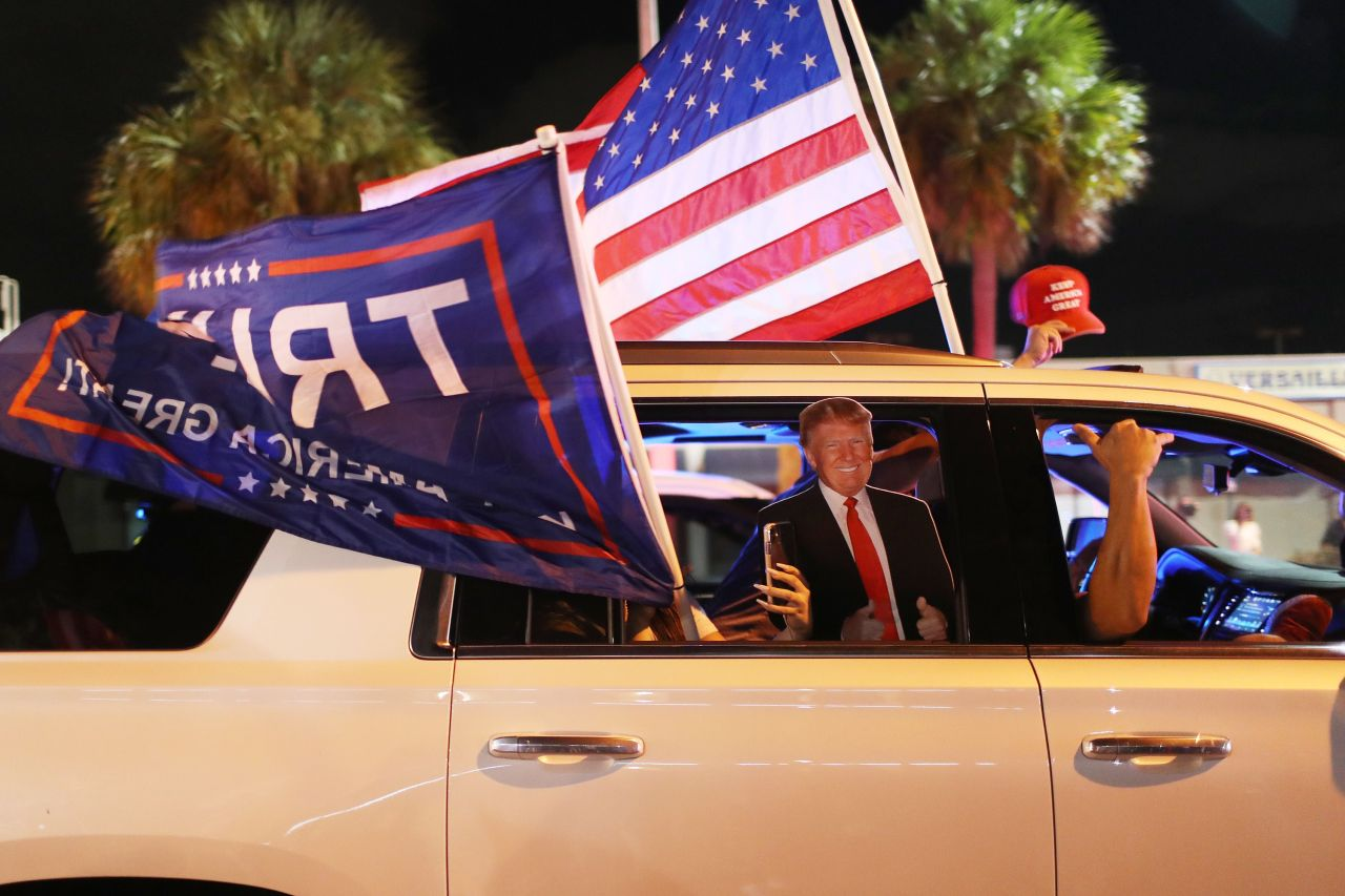 Supporters of US President Donald Trump drive past the Versailles restaurant as they await the results of the presidential election on Tuesday in Miami, Florida. After a record-breaking early voting turnout, Americans head to the polls on the last day to cast their vote for incumbent US President Donald Trump or Democratic nominee Joe Biden in the 2020 presidential election. (AFP-Yonhap)