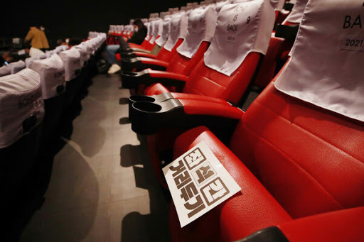 This file photo taken last Wednesday, shows social distancing at a movie theater in Seoul. (Yonhap)