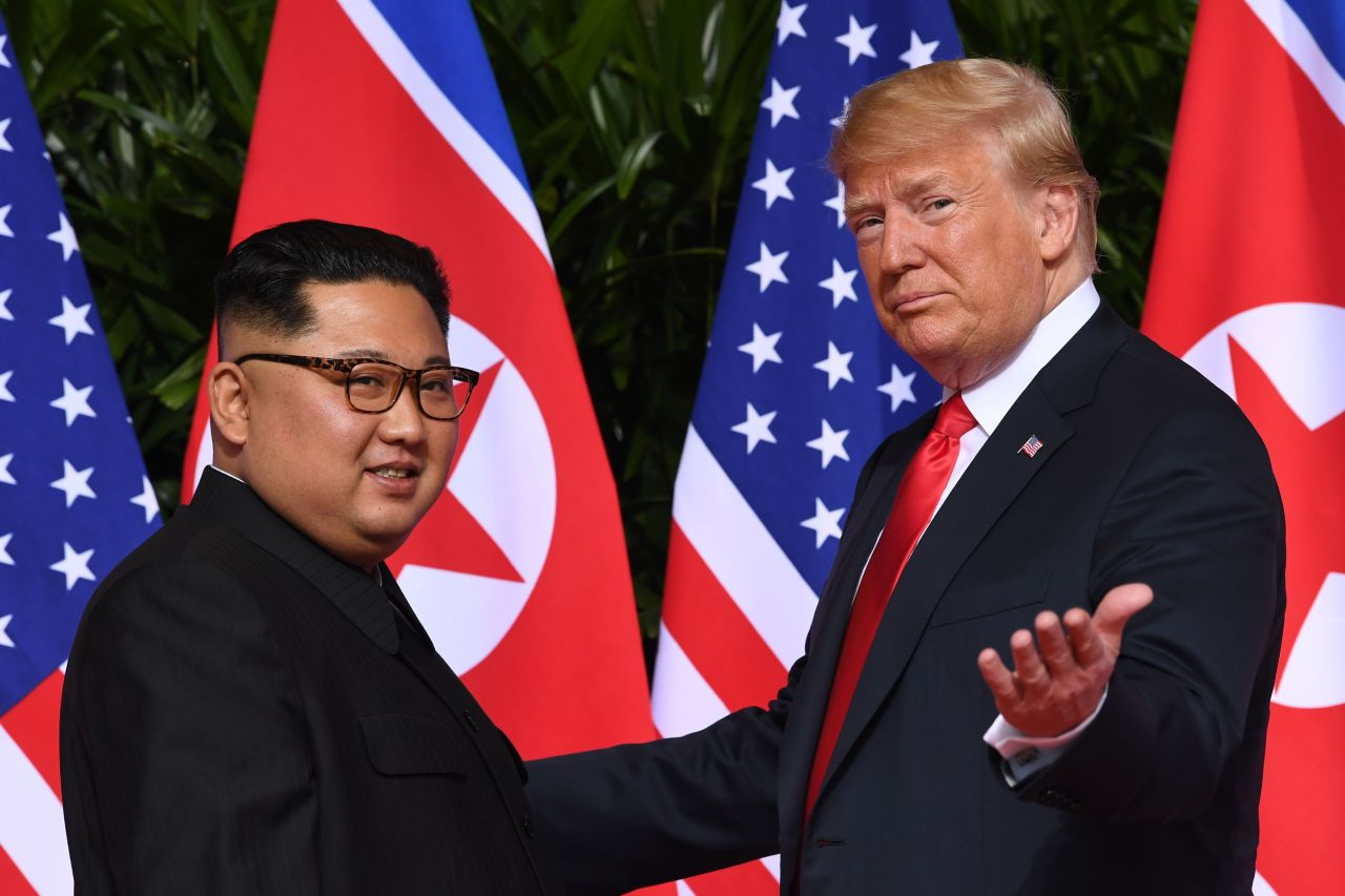 US President Donald Trump (right) meets with North Korea's leader Kim Jong-un at the start of their US-North Korea summit, at the Capella Hotel on Sentosa Island in Singapore on June 12, 2018. (AFP-Yonhap)