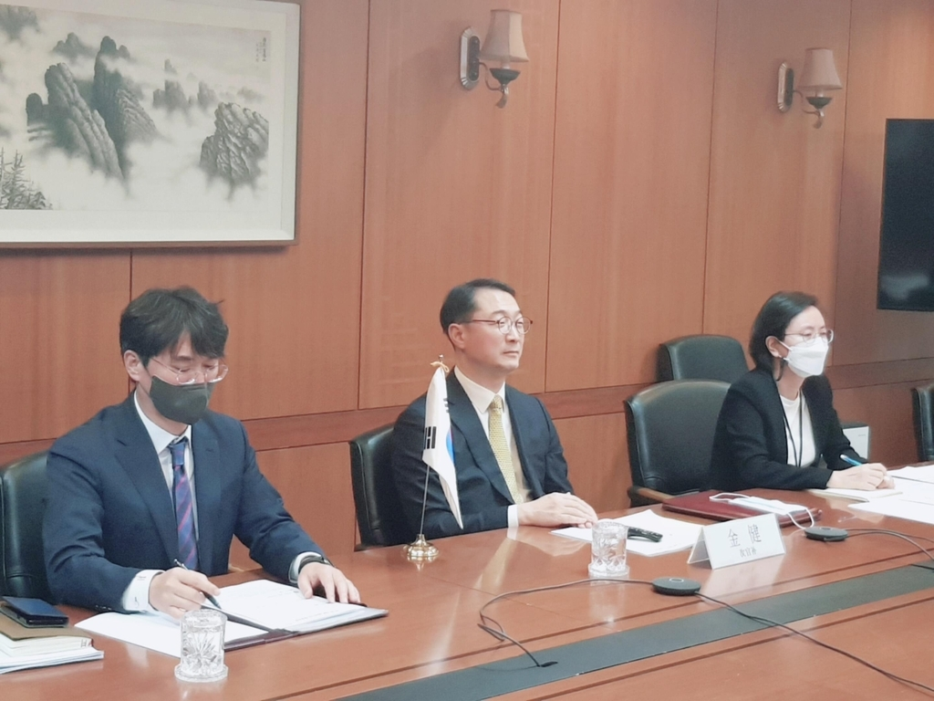 Deputy Foreign Minister Kim Gunn (C) speaks during a virtual meeting with his Chinese counterpart, Luo Zhaohui, on Monday. (Ministry of Foreign Affairs)
