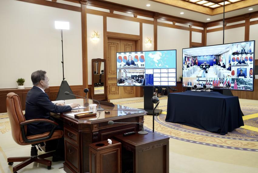 This file photo shows South Korean President Moon Jae-in holding a teleconference with leaders of the 10-member Association of Southeast Asian Nations, China and Japan at the presidential office Cheong Wa Dae in Seoul on April 14, to discuss ways to tackle the new coronavirus pandemic, in this photo released by the presidential office. (Cheong Wa Dae)