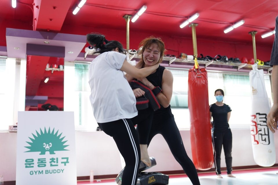 Women practice boxing at a studio. (Gym Buddy)