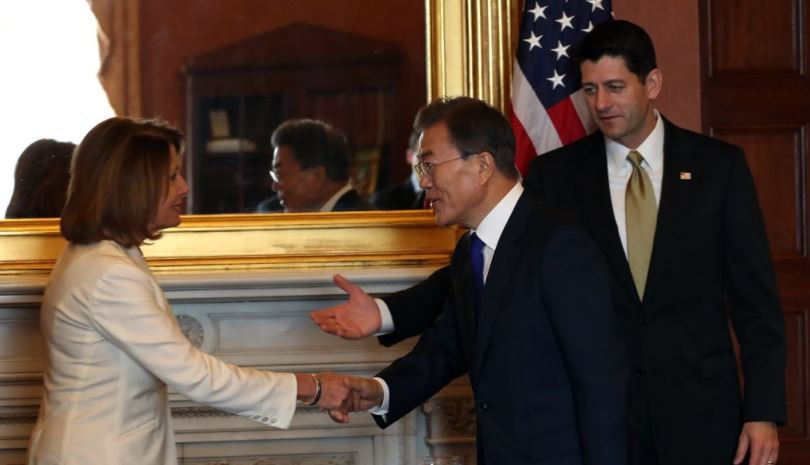 President Moon Jae-in (C) shaking hands with Nancy Pelosi, then US House Democratic leader, ahead of a meeting with House leaders at the Capitol Hill in Washington DC. on June. 29 2017. (Yonhap)