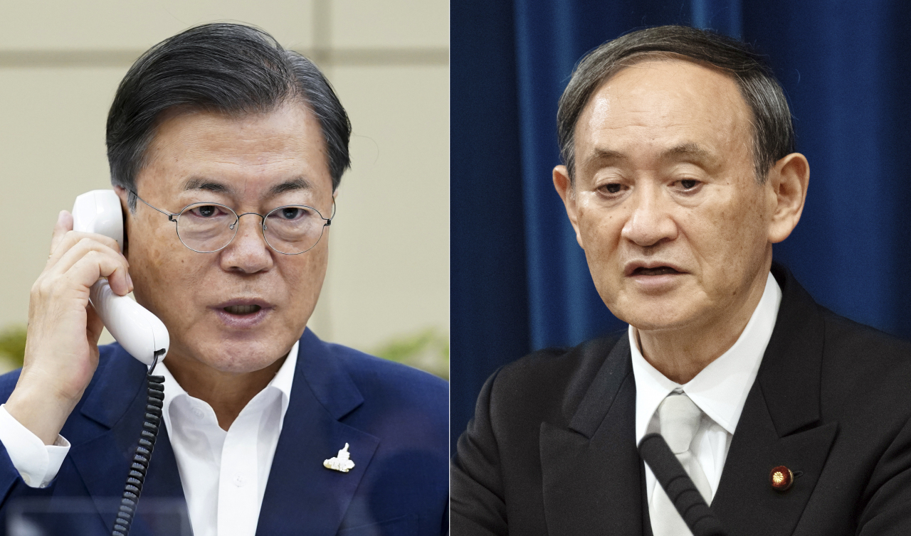 South Korean President Moon Jae-in and Japanese Prime Minister Yoshihide Suga (Yonhap)
