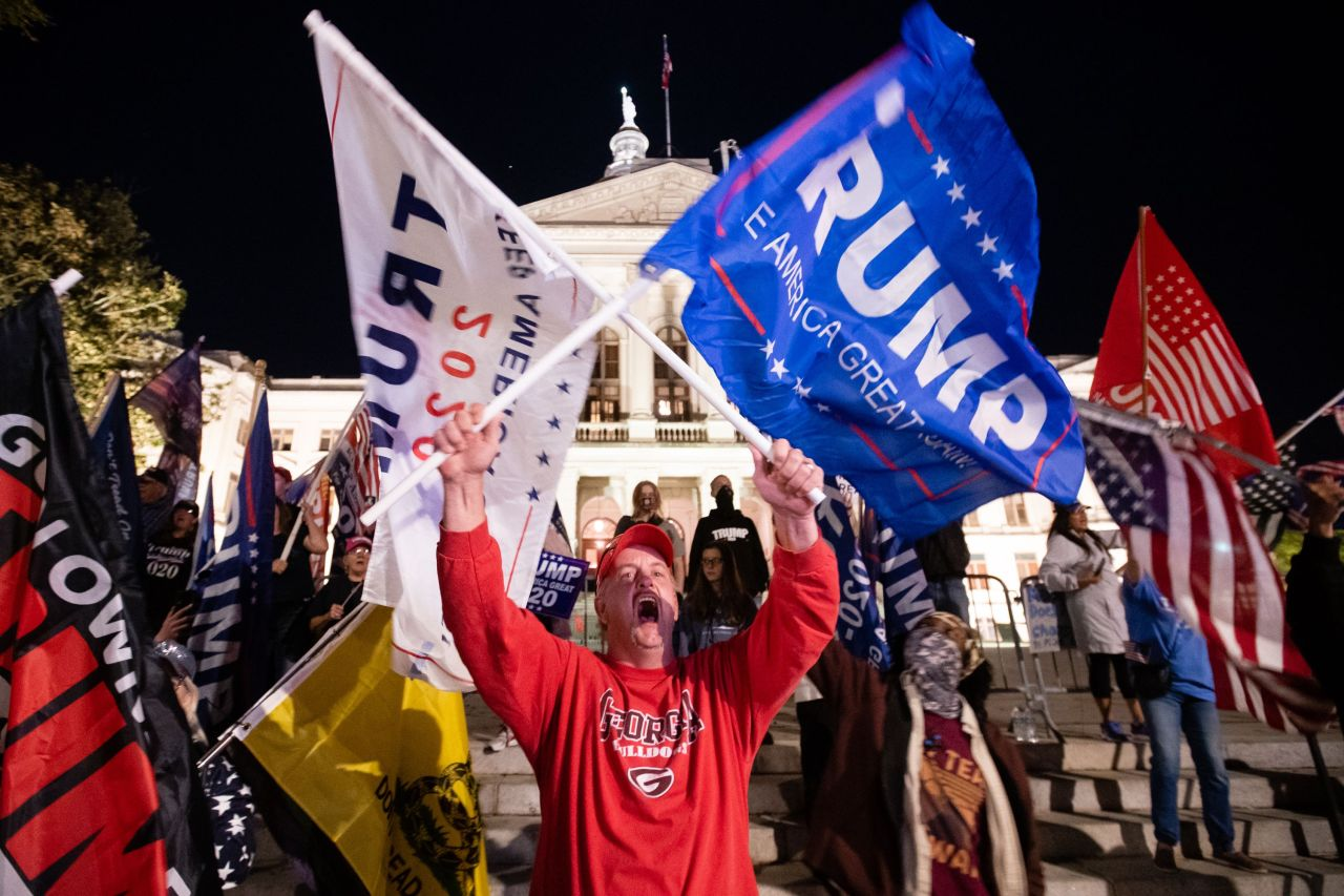 A supporter of President Trump yells at counter-protesters across the street during a rally to protest the election results outside the Georgia State Capitol on Saturday in Atlanta, Georgia. President-elect Joe Biden has been declared the winner in Georgia, becoming the first Democratic nominee to win the state since 1992. (AFP-Yonhap)